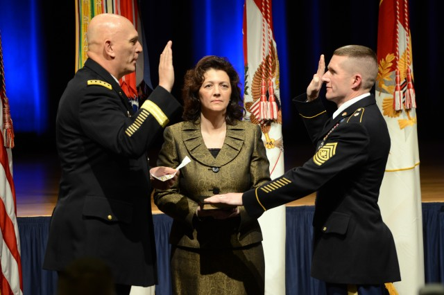 Chief of Staff of the Army Gen. Ray Odierno administers the oath of office to the Sgt. Maj. of the Army Daniel A. Dailey, Jan. 30, 2015, at the Pentagon. Dailey's wife, Holly, holds a bible.