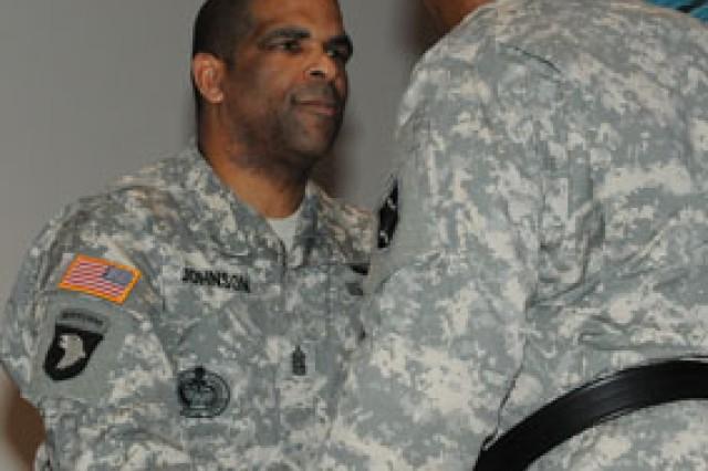 Command Sgt. Maj. Curtis Johnson, MSCoE NCOA commandant, passes the MSCoE colors to Maj. Gen. Leslie Smith, MSCoE and Fort Leonard Wood commanding general.