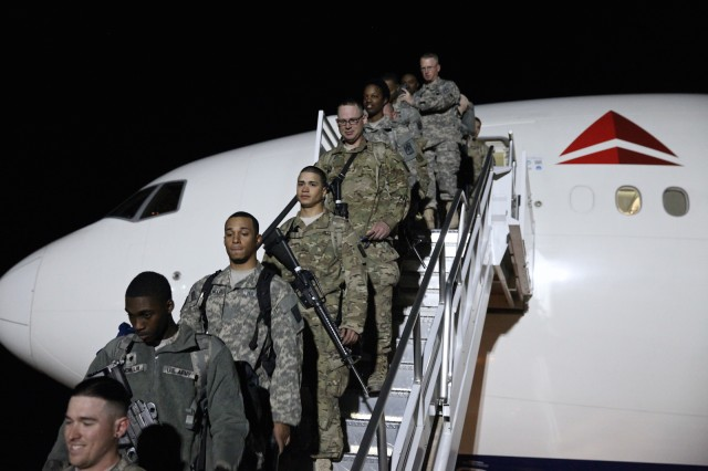 Members of the 40th Expeditionary Signal Battalion deplane at Libby Army Airfield Wednesday night after returning from a nine-month deployment supporting communications contingency operations in support of Operations Enduring Freedom, Inherent Resolve and Spartan Shield in southwest Asia. The Soldiers were later reunited with their families and friends at Fort Huachuca's Barnes Field House.