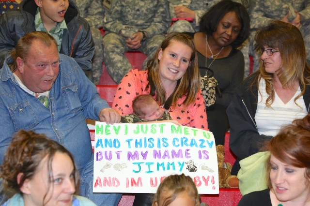 One-month-old James Jr. takes a nap in Alisha Turner's arms on Wednesday at Barnes Field House as they await the return of Spc. James Turner, 40th Expeditionary Signal Battalion, from his nine months supporting communications contingency operations in support of Operations Enduring Freedom, Inherent Resolve and Spartan Shield in southwest Asia.