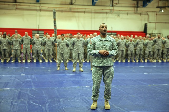 Col James Parks III, commander of the 11th Tactical Theater Signal Brigade — the unit to which the 40th Renegades belong — greets the returning Soldiers at Barnes Field House Wednesday. He and his wife saw them off on May 4, 2014, and were determined to be there when the Soldiers redeployed, making the drive from Fort Hood, Texas, just for the occasion.