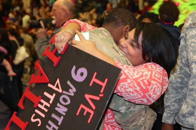 Families of the 40th Expeditionary Signal Battalion are reunited Wednesday after their Soldiers redeploy from nine months of supporting communications contingency operations in southwest Asia. The mood was festive due to the laughter, smiles, tears, hugging and kissing at Barnes Field House as families and friends saw Soldiers they'd not seen during the whole time the Service members were deployed .