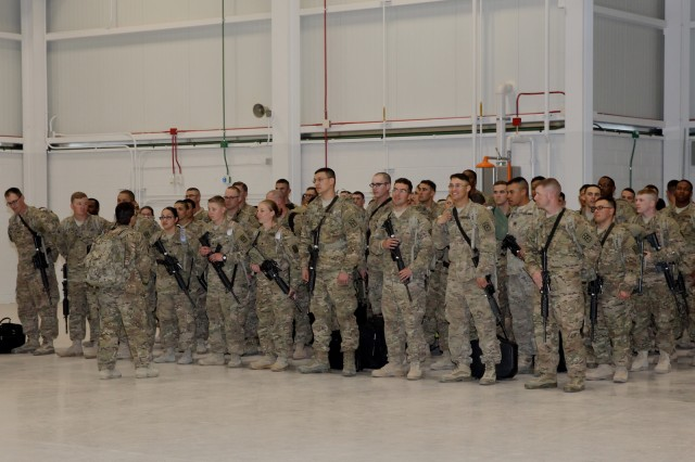 Members of the 40th Expeditionary Signal Battalion, after returning from a nine-month deployment supporting communications contingency operations in support of Operations Enduring Freedom, Inherent Resolve and Spartan Shield in southwest Asia, wait patiently to board buses headed to Barnes Field House to see their loved ones Wednesday.