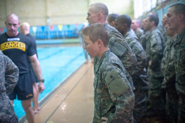 Male and female Ranger Training Assessment Course students demonstrate their knowledge of combat water survival techniques at the Briant Wells Gym indoor pool during the Ranger Training Assessment Course at Fort Benning, Ga., Jan. 23, 2015. The combat water survival training included a 15-meter swim.