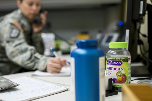 A bottle of women's multivitamins sits on the desk of, 1st. Sgt. Raquel Steckman, the first female in the Army appointed to a sapper company as a first sergeant, now with the 374th Engineer Company (Sapper), headquartered in Concord, Calif. (U.S. Army photo by Sgt. 1st Class Michel Sauret)