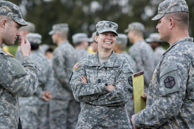 First Sgt. Raquel Steckman, with the 374th Engineer Company (Sapper), headquartered in Concord, California, jokes with her Soldiers before the start of formation. Steckman is the first woman in the Army appointed to a sapper company as a first sergeant. (U.S. Army photo by Sgt. 1st Class Michel Sauret)