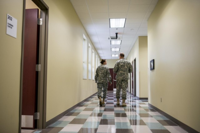 First Sgt. Raquel Steckman (left) discusses unit issues with her company commander, Capt. Nick Niedenthal, on their first battle assembly together with the 374th Engineer Company (Sapper), Army Reserve unit headquartered in Concord, California. Steckman is the first woman in the Army appointed to a sapper company as a first sergeant. (U.S. Army photo by Sgt. 1st Class Michel Sauret)