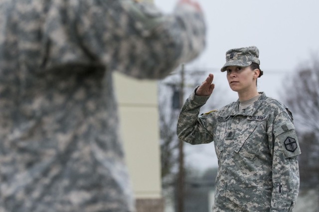 First Sgt. Raquel Steckman salutes her platoon sergeants with the 374th Engineer Company (Sapper), headquartered in Concord, Calif., during formation. Steckman is the first female in the Army appointed to a sapper company as a first sergeant. (U.S. Army photo by Sgt. 1st Class Michel Sauret)