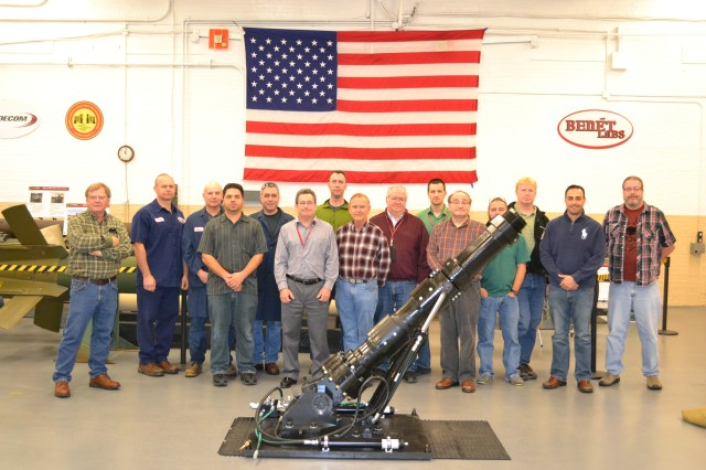 The extended range 120mm mortar system is flanked by Benet Laboratories' mechanical engineers and scientists, who participated in its research and design.