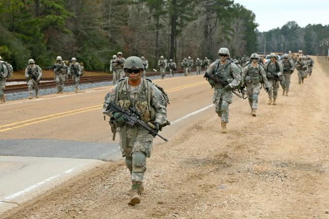 2nd Battalion, 4th Infantry Regiment Soldiers conduct six mile ruck march to range 6-A on February 5, 2015. The ruck and subsequent range qualification is part of an Emergency Deployment Readiness Exercise conducted to ensure the unit is deployment ready at any given time.
