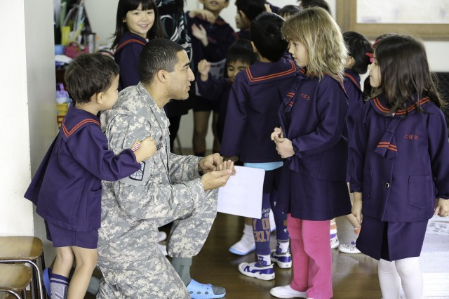 1st Lt. KiAndre Chambers, 349th Signal Company teaches English to children at the Kobato Preschool in Yomitan Village Feb. 9. Chambers, who has been on island for a little more than a month, has taken to volunteering to immerse himself in the community.