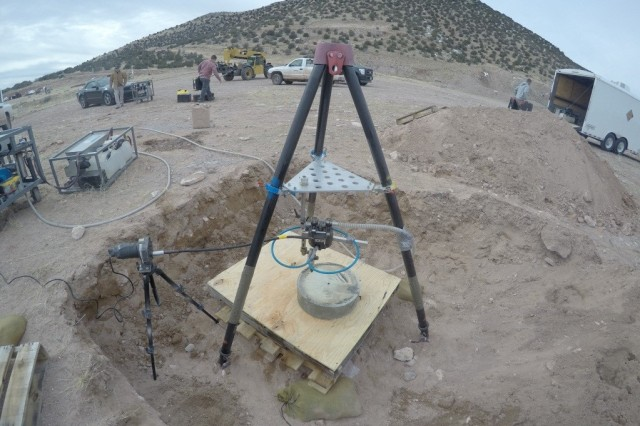Soldiers from the 21st Explosive Ordnance Disposal Company (Weapons of Mass Destruction) conducted the first ever test of the liquid abrasive cutter on high explosives at New Mexico Tech's Energetic Material Research and Testing Center Jan. 29.