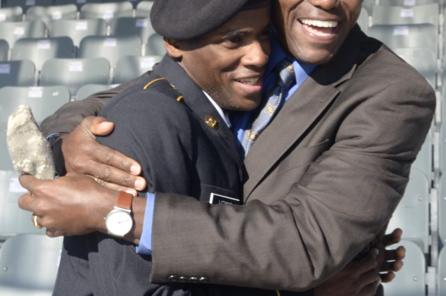 Olympic great Carl Lewis congratulates his son, Pvt. Bakim Lewis, on graduating Basic Combat Training Feb. 5, 2015, at Hilton Field on Fort Jackson, S.C. Pvt. Lewis will move on to Advanced Individual Training at Fort Lee, Va., to become an automated logistical specialist.