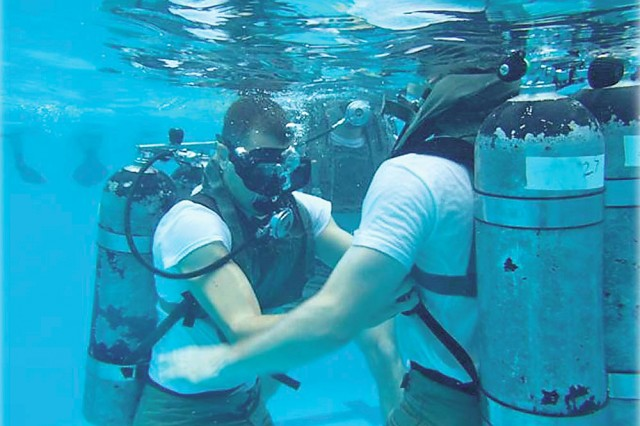 The graduates of Phase I continue training with Company A in Panama City, Florida, at the Naval Diving and Salvage Training Center. Army divers perform tasks such as reconnaissance, demolition and salvage in underwater conditions.