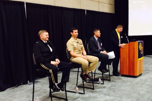 """Speaking during a """"fireside chat"""" panel at the West 2015 defense and technology exhibition this week, Army Maj. Gen. Daniel P. Hughes, left, and Navy Rear Adm. Christian """"Boris"""" Becker, center, stressed the importance of joint cooperation and incremental network modernization."""