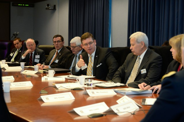 Participants from a variety of Veterans Service Organizations and Military Support Organizations attend a summit, Feb. 11, 2015, listening to ways the Defense Department plans to make access to installations a lot easier in the near future.
