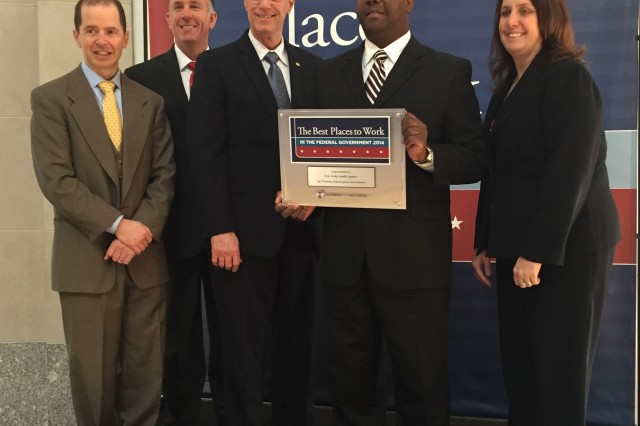 The 2014 Best Places to Work in the Federal Government Award Presentation. (L-R) Max Stier, President and CEO, Partnership for Public Service; USAAA Deputy Auditor General Joseph Bentz; Auditor General Randall Exley; and staff members Ira Smallwood and Elizabeth Casciaro at the ceremony honoring the Best Places to Work in the Federal Government.
