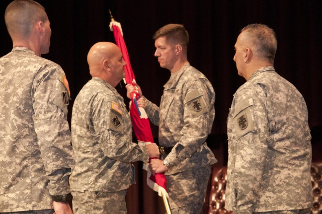 U.S. Army Reserve Command Sgt. Maj. Ronald Flubacher (center left) relinquishes responsibility as the senior enlisted adviser of the 412th Theater Engineer Command by passing the guidon to Maj. Gen. Tracy A. Thompson, commanding general, 412th TEC. Flubacher relinquished command to Command Sgt. Maj. Richard Castelveter in a ceremony Feb. 7 in Montgomery, Ala. (U.S. Army photo by Staff Sgt. Debralee Best)