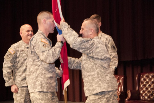 U.S. Army Reserve Command Sgt. Maj. Richard Castelveter (right), senior enlisted adviser, 412th Theater Engineer Command, returns the guidon after accepting responsibility for the 412th TEC in a ceremony Feb. 7 in Montgomery, Ala. (U.S. Army photo by Staff Sgt. Debralee Best)