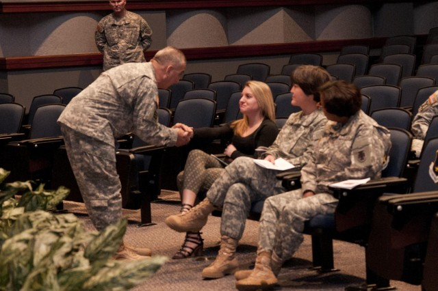 U.S. Army Reserve Command Sgt. Maj. Richard Castelveter (right), senior enlisted adviser, 412th Theater Engineer Command, thanks Gretchen Flubacher, daugther of Command Sgt. Maj. Ronald Flubacher, for her sacrifices during his career. Flubacher relinquished responsibility of the 412th TEC to Castelveter during a ceremony Feb. 7 in Montgomery, Ala. (U.S. Army photo by Staff Sgt. Debralee Best)