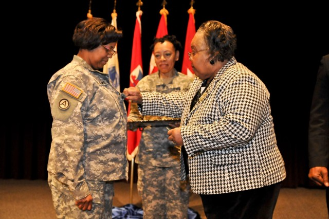 Shirley Williams (right) places the rank of brigadier general on her daughter, U.S. Army Reserve Col. Donna Williams. Williams was promoted to brigadier general in a ceremony Feb. 6 in Montgomery, Ala. The Vicksburg, Miss., native is the deputy commanding general of support for the 412th Theater Engineer Command. (U.S. Army photo by Staff Sgt. Debralee Best)