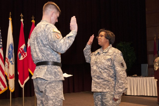 U.S. Army Reserve Brig. Gen. Donna Williams (right) takes the oath of office following her promotion to brigadier general in a ceremony Feb. 6 in Montgomery, Ala. The Vicksburg, Miss., native is the deputy commanding general of support for the 412th Theater Engineer Command. (U.S. Army photo by Staff Sgt. Debralee Best)