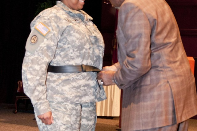 U.S. Army Reserve Brig. Gen. Donna Williams receives her belt, placed around her waist by her mentor, Col. (Ret.) Cornelius Easter, following her promotion to brigadier general in a ceremony Feb. 6 in Montgomery, Alabama. The history of the general officers belt dates back to World War II with an order by the Army Chief of Staff for the belt to be issued to all general officers. The thick, black belt, with an 18 carat gold plated buckle with the imprint of an eagle was first produced in 1944. The Vicksburg, Miss., native is the deputy commanding general of support for the 412th Theater Engineer Command. (U.S. Army photo by Staff Sgt. Debralee Best)