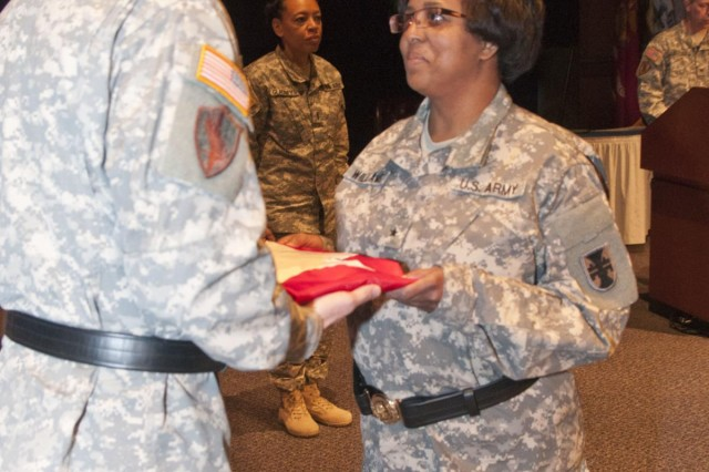 U.S. Army Reserve Brig. Gen. Donna Williams receives her general officer flag from Maj. Gen. Tracy A. Thompson, commanding general, 412th Theater Engineer Command, following her promotion to brigadier general in a ceremony Feb. 6 in Montgomery, Ala. Williams, a Vicksburg, Miss., native, is the deputy commanding general of support for the 412th TEC. (U.S. Army photo by Staff Sgt. Debralee Best)