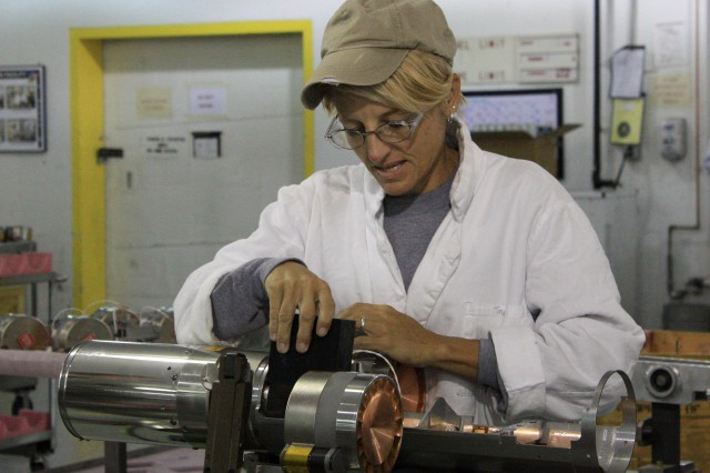"Tina Hamilton, an explosives production worker in the Ammunition Operations Directorate at McAlester Army Ammunition Plant, Okla., works on the BLU-108 ""smart"" submunition. It is intended to defeat soft and heavy armored targets on land or at sea. The BLU-108 is assembled by MCAAP employees as part of a public-private partnership contract that the Army has with Textron Defense Systems."