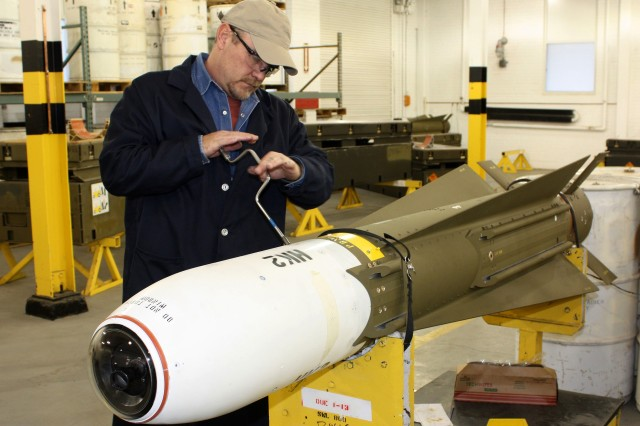Mike Gross, an employee in the Precision Munitions Division at McAlester Army Ammunition Plant, Okla., closes the guidance control section of an AGM-65 Maverick missile after replacing the old part. The Maverick is one of the precision munitions that MCAAP performs maintenance on under a public-private partnership with Raytheon Company.