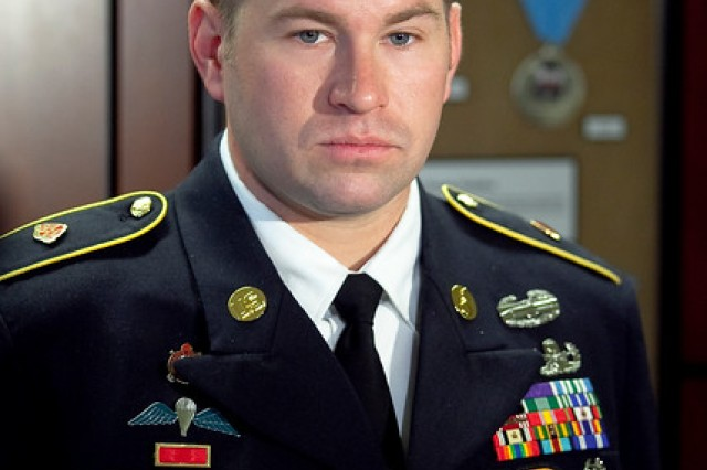 Staff Sgt. Jeffery M. Dawson receives the Distinguished Service Cross, the nation's second highest medal for valor, during a ceremony on Fort Benning, Georgia, Feb. 17, 2015.
