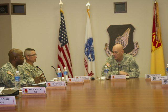 Army Chief of Staff Gen. Ray Odierno discusses the significance of integrated air and missile defense with the 94th Army Air and Missile Defense Command's staff directorates during his visit to the 94th AAMDC's headquarters at Joint Base Pearl Harbor-Hickam, Hawaii, Feb. 11, 2015.