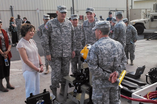 Army Chief of Staff Gen. Ray Odierno is briefed on Army dive operations from the 7th Dive Detachment, 84th Engineer Battalion, 130th Engineer Brigade, 8th Theater Sustainment Command, at Joint Base Pearl Harbor-Hickam, Hawaii, Feb. 12, 2015.