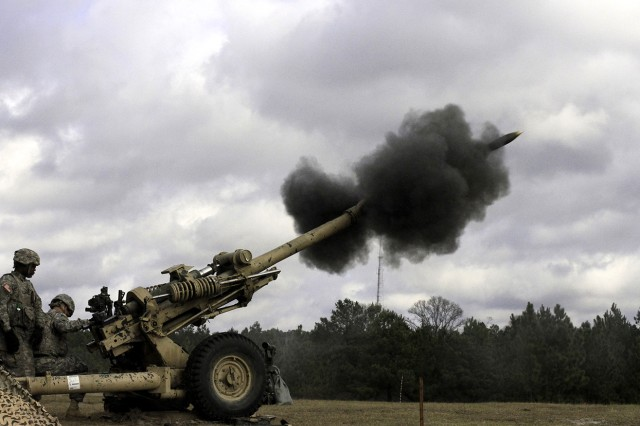 Artillerymen of B Battery, 2nd Battalion, 15th Field Artillery Regiment, fire a 105 mm high-explosive round from the M119 howitzer in support of infantry ground maneuver elements Feb. 8 at Fort Polk, La.