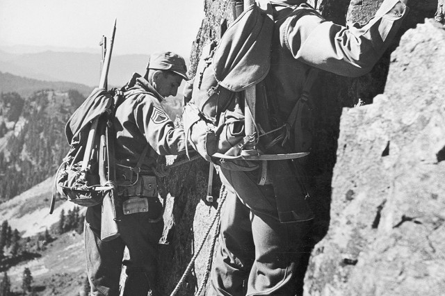 """Assault climbers"" from the 10th Light Infantry (Alpine) rockclimb stateside. Members of the Army's first mountain division were hand-picked for their cold-weather and mountaineering skills."