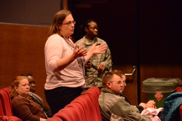 ANSBACH, Germany (Feb. 20, 2015) -- Jodee Watters, U.S. Army Garrison Ansbach community member, asks a question at the Bismarck Kaserne town hall. USAG Ansbach held community town halls at the Storck Barracks and Bismarck Kaserne theaters Feb. 11. (U.S. Army photo by Bryan Gatchell, USAG Ansbach Public Affairs)