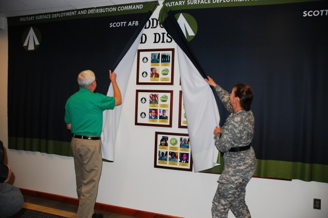 U.S. Army Maj. Gen. Susan A. Davidson, commanding general of Military Surface Deployment and Distribution Command and William Lucas, previous deputy to the commander, unveil the SDDC Global Deployment and Distribution Excellence Award Winners Wall as part of the command's 50th anniversary celebration at the command's headquarters at Scott Air Force Base, Illinois.