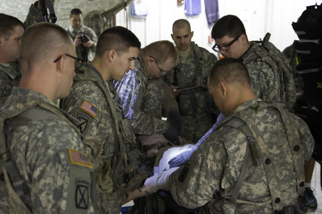 Sgt. Sean Kelly (second from left), treatment NCO assigned to Hellcat Company, Headquarters and Headquarters Troop, 1st Squadron, 89th Calvary Regiment, 2nd Brigade Combat Team, observes Pfc. Devon Moore and Pvt. Jared Morin (Soldiers on right), both combat medics, perform life saving intervention treatment on a notional casualty Feb. 10 during their month long Joint Readiness Training Center rotation at Fort Polk, La. The medical section conduct impromptu casualty care exercises every day