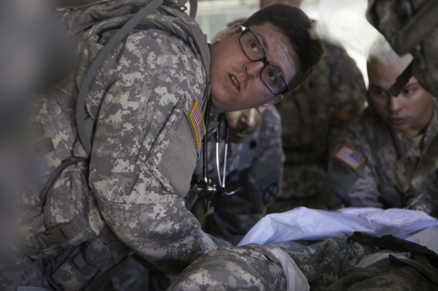 Pvt. Jared Morin, a Hellcat combat medic assigned to Headquarters and Headquarters Troop, 1st Squadron, 89th Calvary Regiment, 2nd Brigade Combat Team, turns to listen to guidance from his leadership while he is performing a notional casualty treatment exercise Feb. 11 at Joint Readiness Training Center, Fort Polk, La. Morin and his fellow medics participate in scenarios daily to sharpen their techniques and learn how to improvise in a emergency