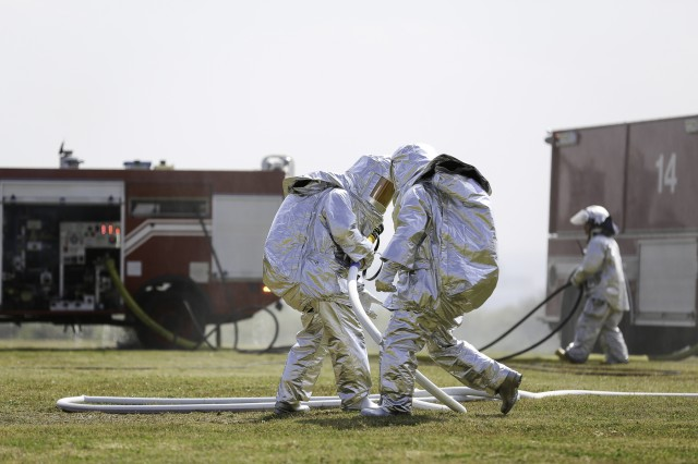 Japanese first responders teamed up with the various services on Okinawa Feb. 17, to participate in a simulated aircraft mishap exercise at Torii Station designed to review procedures for responding to an off-base incident, while deepening mutual understanding and cooperation between the allied nations.