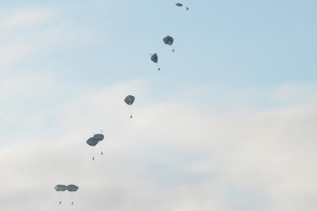 Paratroopers, with U.S. Army Alaska's 4th Infantry Brigade Combat Team (Airborne), 25th Infantry Division, descend to the ground under T-11 parachute canopies during Exercise Spartan Pegasus at Deadhorse, Alaska, Feb. 24, 2015.
