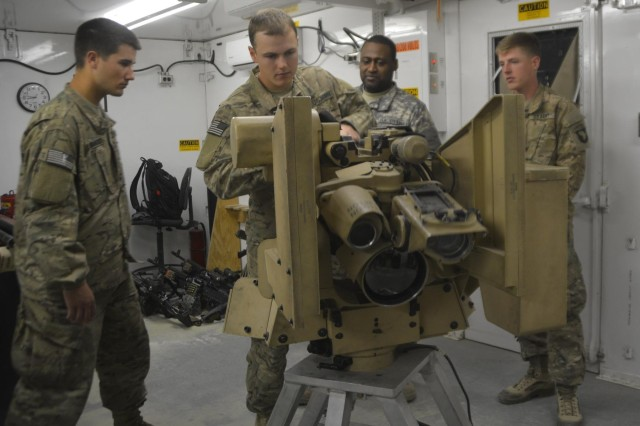 A training specialist deployed from TACOM Detroit Arsenal (second from right), observes Soldiers from 3rd Battalion, 187th Infantry Regiment who are completing operator training on the Common Remotely Operated Weapons Station at Bagram Air Field. CROWS has a sensor suite and fire control software and it can be mounted on more than 20 platforms and accommodate four different weapons. CROWS equipped units can acquire and engage targets while protected inside an armored vehicle.
