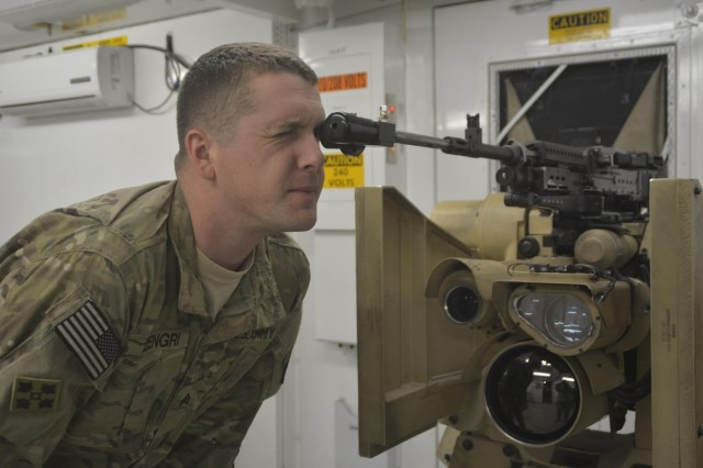 Sgt. Jesse R. Zengri, a Panama City, Fla., native and team leader with C Co., 1st Squadron, 33rd Cavalry, conducts a bore sighting to align the weapon mounted on a Common Remotely Operated Weapons Station with the camera inside the CROWS at Bagram Airfield. CROWS has a sensor suite and fire control software and it can be mounted on more than 20 platforms and accommodate four different weapons. CROWS equipped units can acquire and engage targets while protected inside an armored vehicle.