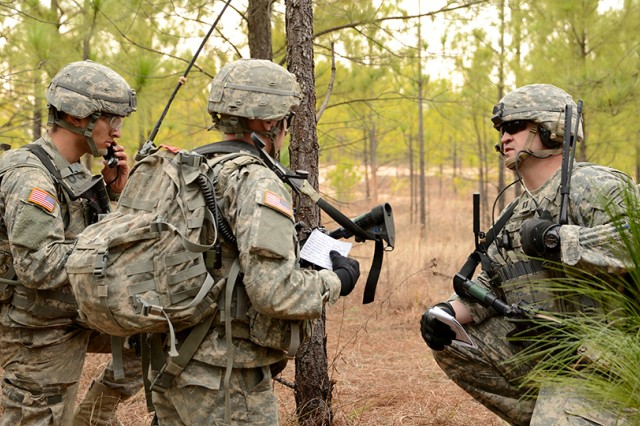 Capt. Travis Young, commander of A Company, 4th Battalion, 31st Infantry Regiment, 2nd Brigade Combat Team, 10th Mountain Division (LI), tells his fire direction officer to call for fire on enemy positions during a live-fire exercise Feb. 15 at Peason Ridge, Joint Readiness Training Center, Fort Polk, La.