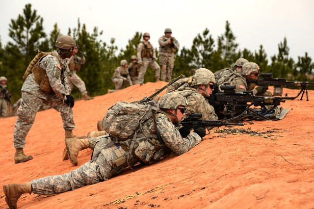 Members of A Company, 4th Battalion, 31st Infantry Regiment, 2nd Brigade Combat Team, 10th Mountain Division (LI), engage a simulated enemy while Joint Readiness Training Center observer - controller / trainers observe their actions during a live-fire range Feb. 15 at Peason Ridge, Joint Readiness Training Center, Fort Polk, La.
