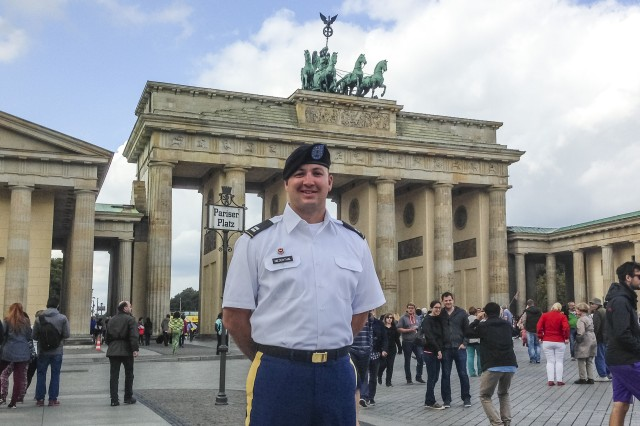 Capt. Nicholas Niedenthal stands by the Brandenburg Gate in Germany, Aug. 23, 2014, during a visit for the Military Reserve Exchange Program last year when he spent two weeks learning about the German military and building international partnership with the U.S. Niedenthal is the former commander of the 374th Engineer Company (Sapper), headquartered in Concord, California. (Courtesy photo)