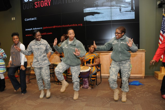 "Soldiers and civilians danced with the Wona Womalan West African Ensemble during the 81st Regional Support Command's annual celebration of African American history Feb. 6. ""The dancers represented the culture, music and look of the root of African American history, which is Africa,"" said Master Sgt. Rosalind Chamberlain, Equal Opportunity Adviser."