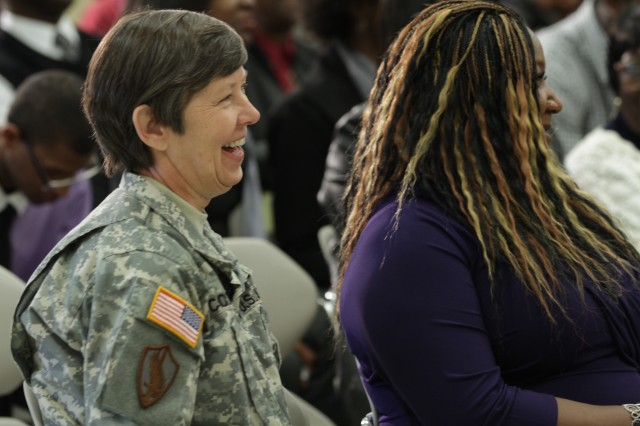 Maj. Gen. Janet Cobb sits with Valerie Thompson, the widow of Staff Sgt. Anthony Thompson, during the memorialization ceremony of the Staff Sgt. Anthony O. Thompson Army Reserve Center in Orangeburg, S.C.