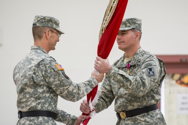 Maj. Gen. David Conboy, deputy commanding general of operations to the U.S. Army Reserve Command and former commanding general of the 416th Theater Engineer Command (TEC), hands the unit flag to Maj. Gen. Lewis Irwin, the incoming TEC commanding general, during his assumption of command ceremony at the Parkhurst U.S. Army Reserve Center, in Darien, Ill., March 7. Irwin is a professor of public policy and government at Duquesne University in Pittsburgh. (U.S. Army photo by Sgt. 1st Class Michel Sauret)