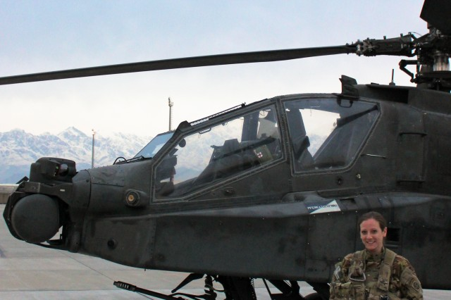 Chief Warrant Officer 2 Tristan Archambault and her AH-64D Apache Longbow attack helicopter at Bagram Airfield, Afghanistan. Archambault is the only female pilot in Task Force Wolfpack of the 82nd Combat Aviation Brigade.